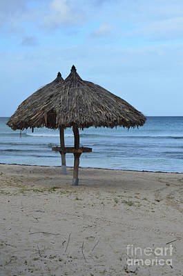 Photograph - Pair Of Deserted Palapas On A Beach In Aruba. by DejaVu Designs