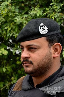 Photograph - Pakistani Police Officer With Black Beret And Insignia Peshawar Pakistan by Imran Ahmed