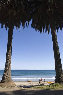 Gaviota Photograph - Palm Trees Frame Three People by Rich Reid