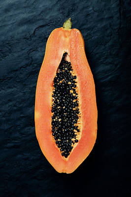 Slate Photograph - Papaya Cross-section On Dark Slate by Johan Swanepoel