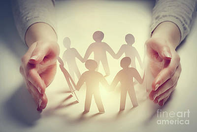 Creative Photograph - Paper People Surrounded By Hands In Gesture Of Protection by Michal Bednarek