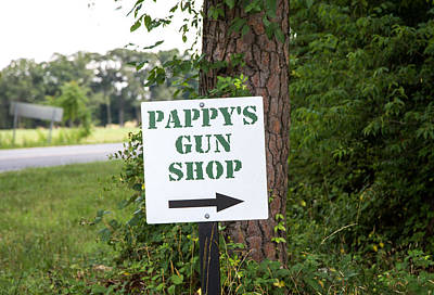 Photograph - Pappy's Gun Shop by Charles Hite