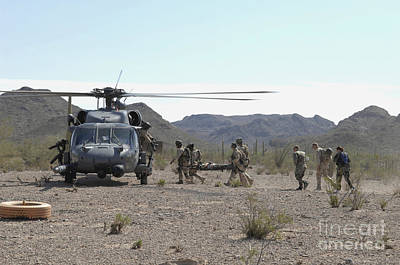 Pararescuemen Transport Rescuees To An Art Print