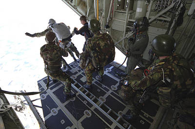 Foreign Military Photograph - Paratroopers Jump From A C-130 Hercules by Andrew Chittock