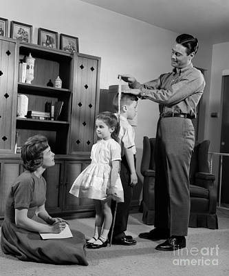 Back To Life Photograph - Parents Masuring Childrens Height by H. Armstrong Roberts/ClassicStock