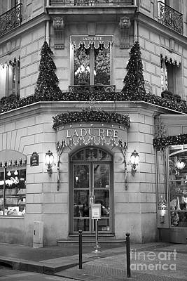 Photograph - Paris Laduree Christmas Lights - Paris Black And White Prints Laduree Patisserie Macaron Shop by Kathy Fornal
