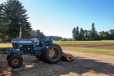 Parked Farm Tractor In Shade After Plowing Field Art Print