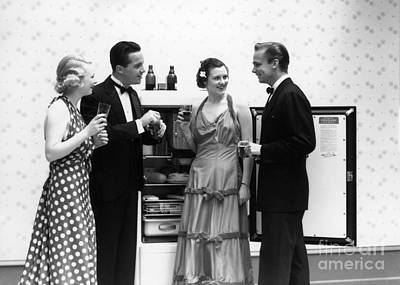 Evening Gown Photograph - Party Guests At Refrigerator, C.1930-40s by H. Armstrong Roberts/ClassicStock