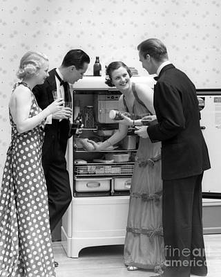 Party Guests At Refrigerator, C.1930s Art Print by H. Armstrong Roberts/ClassicStock