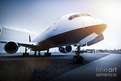 Wings Photograph - Passenger Airplane On The Airport Parking by Michal Bednarek
