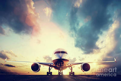 Passenger Plane Photograph - Passenger Airplane Taking Off On Runway At Sunset by Michal Bednarek