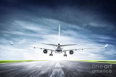 Passenger Plane Photograph - Passenger Airplane Taking Off On Runway by Michal Bednarek