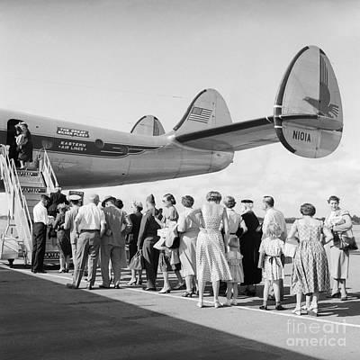 Passenger Plane Photograph - Passengers Boarding A Plane by C.S. Bauer/ClassicStock