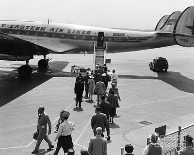 Passenger Plane Photograph - Passengers Boarding A Plane by H. Armstrong Roberts/ClassicStock