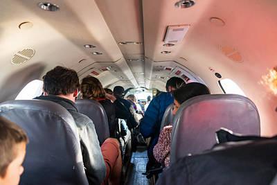 Passenger Plane Photograph - Passengers In Cramped Airplane Cabin by Jess Kraft