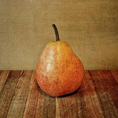 Pears Photograph - Pear On Cutting Board 1.0 by Michelle Calkins