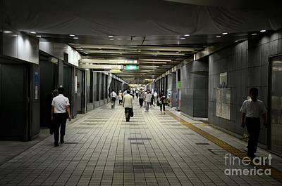 Photograph - Pedestrians Walk Through Underground Tunnel At Shinjuku Station Tokyo Japan by Imran Ahmed