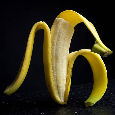 Foodstills Photograph - Peeled Banana. by Bernard Jaubert