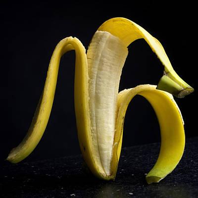 Foodstill Photograph - Peeled Banana. by Bernard Jaubert