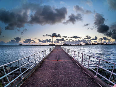 Photograph - Peering Down The Pier by Greg Nyquist