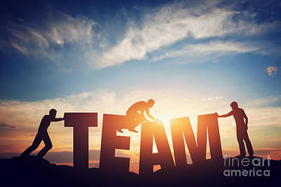 Arrange Photograph - People Connect Letters To Compose The Team Word. Teamwork Concept by Michal Bednarek