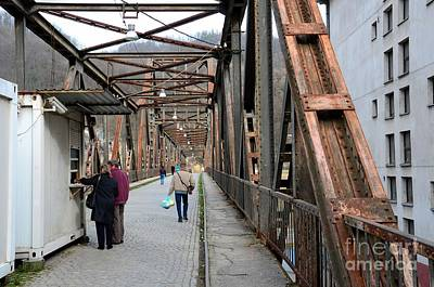 Photograph - People Crossing Old Yugoslav Weathered Metal Bridge Crossing In Bosnia Hercegovina by Imran Ahmed