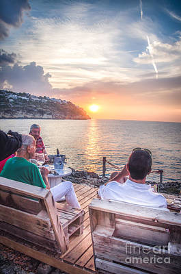 Gravure Photograph - People Drink Canvas An Aperitif Enjoying The Sunset by Luca Lorenzelli