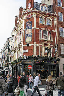 Photograph - People Near A Pub In London by Patricia Hofmeester