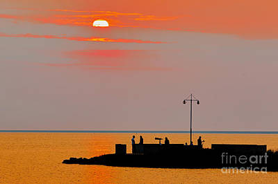 Photograph - People On A Pier During Sunset by Nick  Biemans