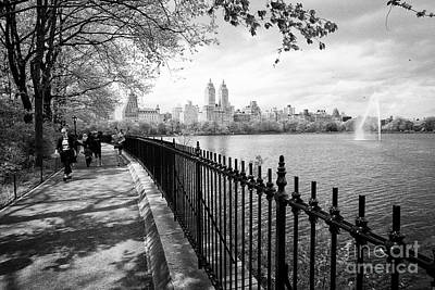 people walking and jogging on cinder track at jacqueline kennedy onassis reservoir central park New  Art Print