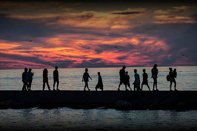 Photograph - People Walking On The Breakwater At Ottawa Beach At Sunset by Randall Nyhof