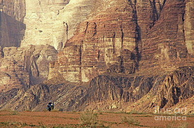 Person Riding A Motorbike Through The Wadi Rum Desert In Jordan Art Print by Sami Sarkis