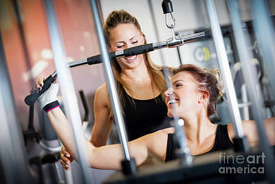 Personal Trainer Helps With Gym Equipment Workout. Art Print