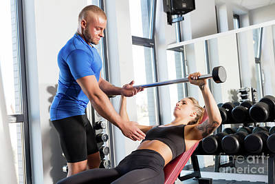 Personal Trainer Working With A Client At The Gym. Art Print