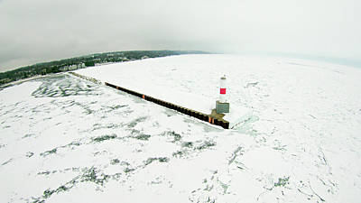 Photograph - Petoskey Harbor Breakwater In Spring With Frozen Lake  by Alex Grichenko