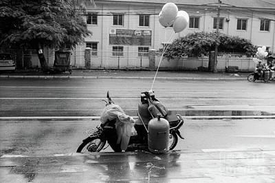 Photograph - Phnom Penh Balloon Salesman by Dean Harte