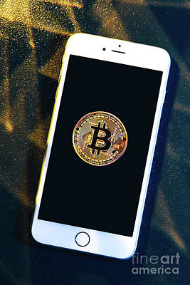 Photograph - Phone With A Bitcoin Laying On Top Of It. by Michal Bednarek
