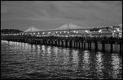 Photograph - Pier 7 And Bay Bridge Lights At Sunset Bw by Bonnie Follett