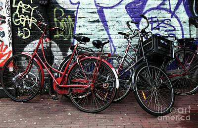 Photograph - Pile Of Bikes by John Rizzuto