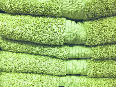 Pile Of Green Towels Art Print by Tom Gowanlock