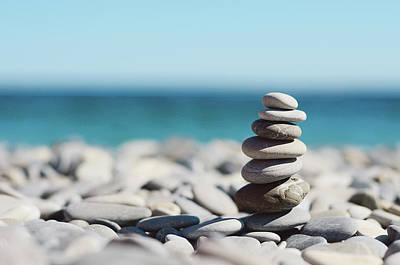 Pile Of Stones On Beach Print by Dhmig Photography