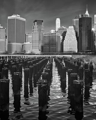 Photograph - Pilings And The New York City Skyline by Jerry Fornarotto