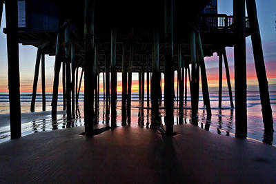 Photograph - Pilings Under The Pier by Ed Fletcher