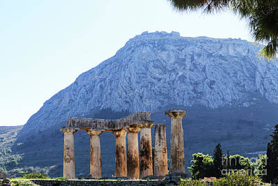 Photograph - Pillars Of Temple Of Apollo In Corith, Greece, With Acrocorinth In Background by Susan Vineyard