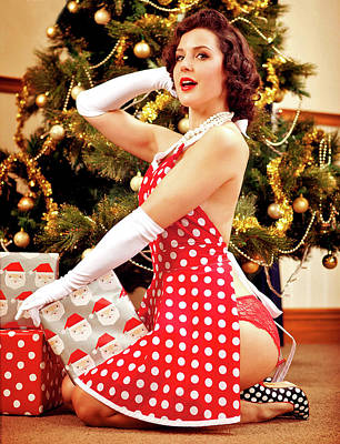 sexy christmas painting pin up woman posing with holiday gifts in front of a christmas