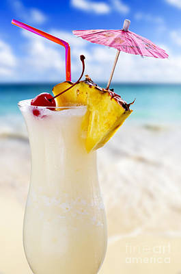 Beach Royalty-Free and Rights-Managed Images - Pina colada cocktail on the beach by Elena Elisseeva