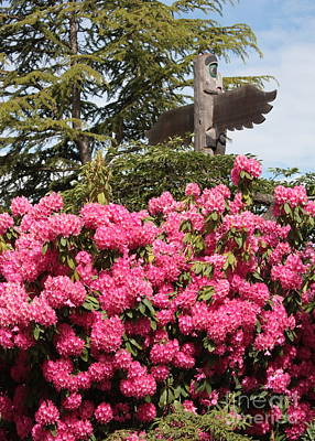 Photograph - Pink Rhododendrons With Totem Pole by Carol Groenen
