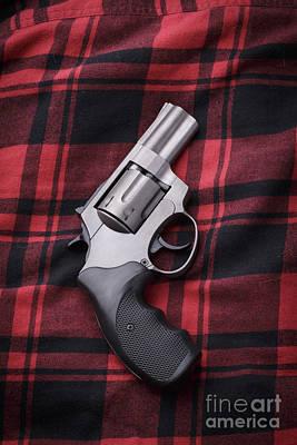 Pistol On A Red Flannel Shirt Art Print