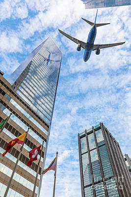 Photograph - Plane Flying Over The City by Benny Marty