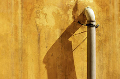 Abstract Photograph - Plastic Pipe And Its Shadow On Brown Textured Wall by Prakash Ghai